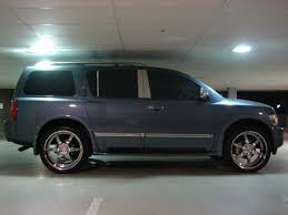 nissan armada with black rims 305 u0027s with 22