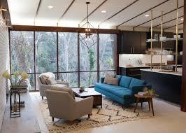 cozy mid century interior design with chenille sofa and retro rug in cozy mid century interior design with chenille sofa