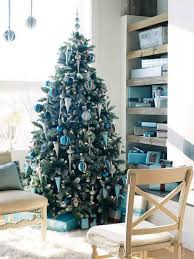 white tree with blue and gold decorations cheminee website