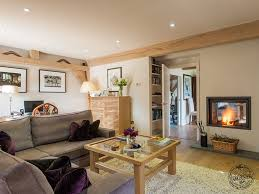 snug living room with fireplace in oak frame house