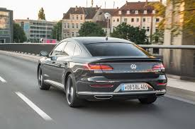 2019 volkswagen arteon r line rear three quarter in motion 02 1