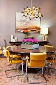 modern dining room decor with flower box and contemporary pendant