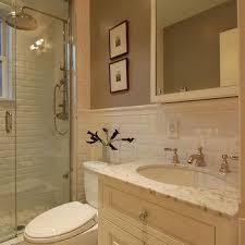 cream mirror with cream washstand transitional bathroom