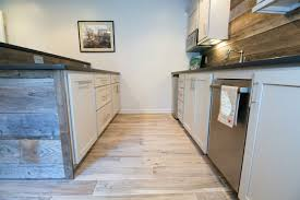 galley way between custom built bar made out of reclaimed wood and