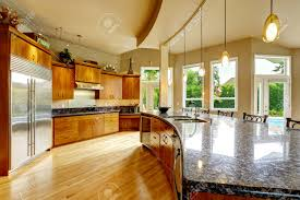 spacious luxury kitchen room with round kitchen island and