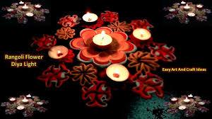 rangoli floral art from bottle cap and rangoli colors with diya