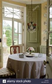 dining table with tablecloth in country style kitchen with stock