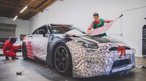 car wrapped in wrapping paper wrapping the gtr in christmas paper