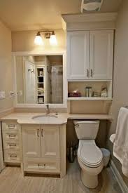 interesting before and after remodelling over toilet storage with