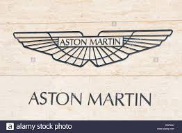 aston martin dealership aston martin sign at a car dealership cheltenham uk stock photo