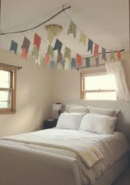 Suspended Loft Bed From Ceiling by Diy Flag Canopy Over Bed Use Branches To Hang From The Ceiling
