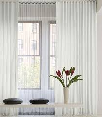 sheer curtains across a wall apartment therapy