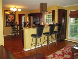 kitchen bar ideas featuring kitchen paint colors accent wall and kitchen bar ideas featuring kitchen paint colors accent wall and cherry wood cabinets include cream bar and breakfast seating together with wooden floor