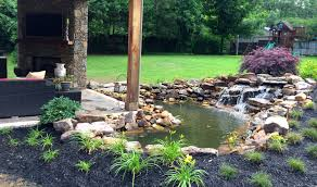Waterfall In Backyard Creating A Soothing Backyard Waterfall Summit Landscapes