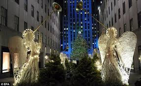 christmas comes to new york rockefeller lights up city but obama