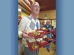 volunteers serve thanksgiving feast to seniors