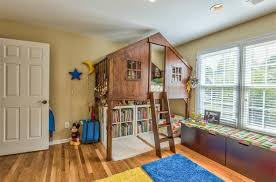 Eclectic Kids Bedroom With Builtin Bookshelf  Window Seat In - Treehouse bunk beds
