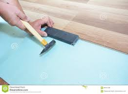 Putting Down Laminate Flooring Man Installing New Laminate Wood Flooring Worker Installing