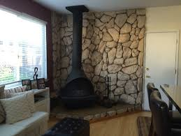 stone wall fireplace removal of 1970s faux rock lava stone wall behind fireplace