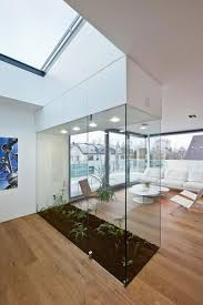 living room green plants in glass wall living room indoor small