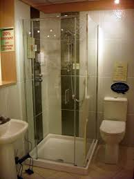 Small Bathroom Shower Designs A Tiled Half Wall Surrounds This En Suite Bathroom Which Is On A