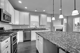 White Kitchen Cabinets And Black Countertops White Kitchens With Countertops White Cabinets With White