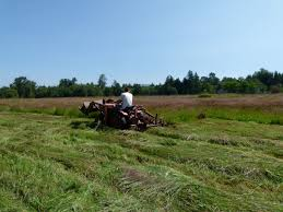 what is the smallest tractor that will pull a swather and then a