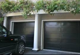 how to design black garage doors telezy com there are many type of black garage door there are sliding door garage and rolling door garage you can choose the door base on your need making a garage