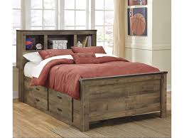 signature design by ashley trinell rustic look full bookcase bed