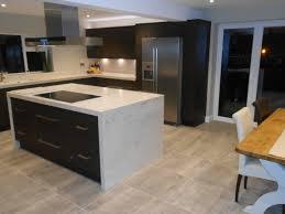 sleek modern kitchen horizontal grain rift oak doors 60mm thick corian clam shell
