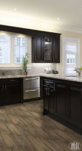Espresso Cabinets With Black Appliances Arabesque Selene Tile Backsplash With Espresso Cabinets And
