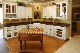 l shaped white finish teak wood kitchen cabinets with drawers and