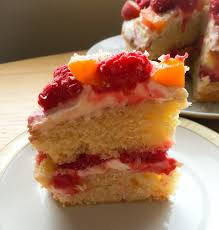 vanilla apricot and raspberry cake with white chocolate frosting