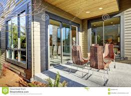 covered porch design backyard covered patio design with high back wicker chairs stock