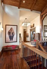 wood railings iron balusters hall rustic with dark wood stairs