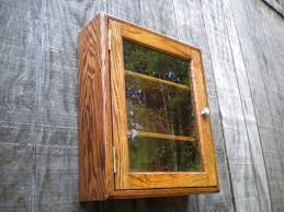 Wooden Cabinet With Glass Doors Curio Cabinet With Glass Door Peytonmeyer Net