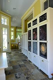 mudroom mudroom idea in white with wall sconces completed with