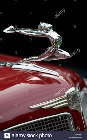 buick ornament and front end of this classic american car