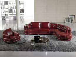 red full grain leather sofa mixed round glass coffee table and