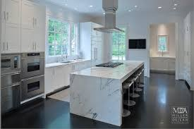 kitchen island with range waterfall island modern kitchen mdd architects