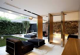 exotic black sofas and cushion applied on the wooden floor of