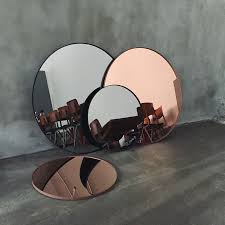 a trendy reflection tinted mirror style round mirrors