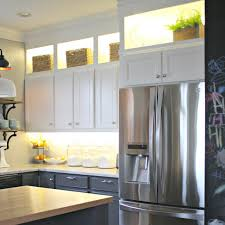 how to put lights above cabinets diy and lower cabinet lighting from thrifty decor
