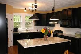 dark cabinets and large pendant lamp decor and stone countertops