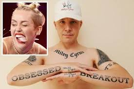 fan says his 29 miley cyrus tattoos are stopping him getting a