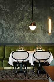 green velvet bench seating and bentwood chairs interior design