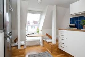 attic kitchen ideas 42 square meter attic apartment with subtle pops of color