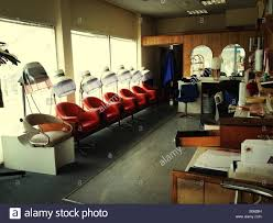 old fashinoned hairdressers and there salon potos interior of old fashioned hairdressing salon stock photo royalty