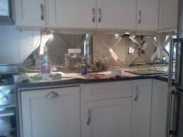 mirrored backsplash in kitchen a mirrored backsplash individually cut mirrors to match customer s