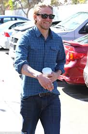 charlie hunnam can u0027t shake his sons of anarchy alter ego as he